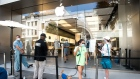GETTY - A customer exits the Apple Store in Charleston, South Carolina on May 13.