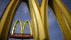 Signage stands outside a McDonald's Corp. fast food restaurant in Bowling Green, Kentucky, U.S. Photographer: Luke Sharrett/Bloomberg