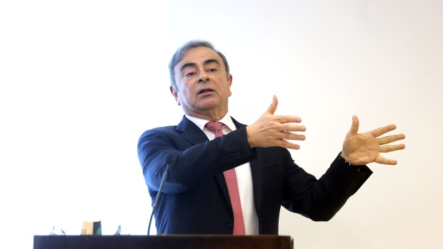 "Carlos Ghosn, former chief executive officer of Nissan Motor Co. and Renault SA, gestures as he speaks to the media at the Lebanese Press Syndicate in Beirut, Lebanon, on Wednesday, Jan. 8, 2020. ""Ripped from my family, my friends, my communities, from Renault, Nissan and Mitsubishi and the 450,000 women and men who comprise those companies. It is impossible to express the depth of that deprivation and my profound appreciation to once again be able to be reunited with my family and loved ones,"" Ghosn said."