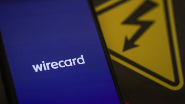 The Wirecard AG payment app launch screen is displayed on an Apple Inc. iPhone X smartphone in this arranged photograph in Frankfurt, Germany, on Tuesday, June 30, 2020. Singapore's financial regulators are working with local police to scrutinize aspects of the case surrounding Wirecard AG, the scandal-ridden German payments company.