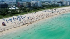 An aerial drone view as beachgoers take advantage of the opening of South Beach on June 10, 2020 in Miami Beach, Florida.