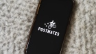 Postmates Inc. signage is displayed on a smartphone in an arranged photograph taken in the Brooklyn borough of New York, U.S., on Wednesday, July 1, 2020. Uber Technologies Inc. is in talks to purchase Postmates Inc., said a person familiar with the discussions, seeking to expand food delivery services in the U.S. and capitalize on a surge in orders during the coronavirus pandemic.