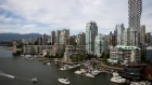 Boats travel in False Creek near the downtown Vancouver, British Columbia, Canada, on Sunday, June 2, 2019. Canada is scheduled to release gross domestic product (GDP) figures on June 28. Photographer: SeongJoon Cho/Bloomberg