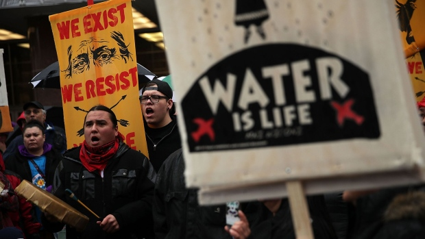 Activists gather outside the Army Corps of Engineers Office to protest against the Dakota Access Pipeline March 10, 2017 in Washington, DC.