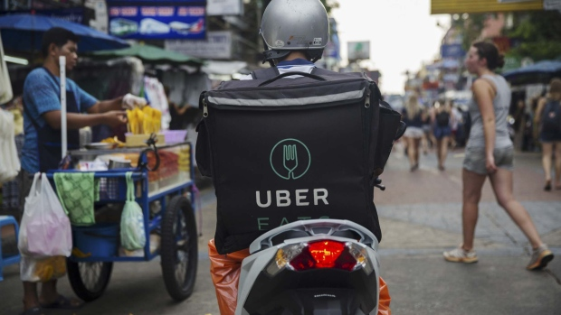 An UberEats, operated by Uber Technologies Inc., branded box sits on a motor scooter in London, U.K., on Thursday, Dec. 22, 2016. The food delivery business model has proven attractive to venture capitalists, who last year poured $5.5 billion into food-delivery companies globally, according to research firm CB Insights.