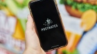 Postmates Inc. signage is displayed on a smartphone in an arranged photograph taken in the Brooklyn borough of New York, U.S., on Tuesday, June 30, 2020. Uber Technologies Inc. is in talks to purchase Postmates Inc., said a person familiar with the discussions, seeking to expand food delivery services in the U.S. and capitalize on a surge in orders during the coronavirus pandemic. Photographer. Gabby Jones/Bloomberg Photographer: Gabby Jones/Bloomberg