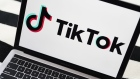 Signage for ByteDance Ltd.'s TikTok app is displayed on a laptop computer in an arranged photograph taken in the Brooklyn borough of New York, U.S., on Wednesday, July 1, 2020. India's unprecedented decision to ban 59 of China's largest apps is a warning to China's tech giants, who for years thrived behind a government-imposed Great Firewall that kept out many of America's best-known internet names. Photographer: Gabby Jones/Bloomberg