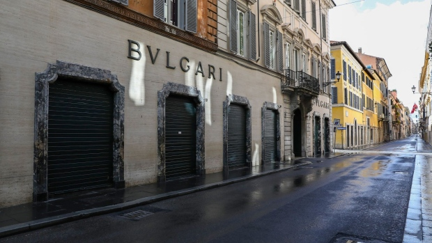 A Bulgari luxury store stands closed along an empty Via Condotti in Rome, Italy, on Friday, March 27, 2020. European Union leaders failed to agree on key details of economic rescue measures, as Italy's coronavirus infections surged despite weeks of restrictions on public life, worsening Europes human cost.