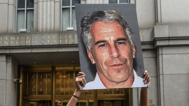 A protester holds up a sign of Jeffrey Epstein in front of the federal courthouse in New York on July 8, 2019. Photographer: Stephanie Keith/Getty Images