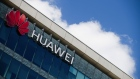 A logo sits on the exterior of the Huawei Technologies France SASU offices in Paris, France, on Tuesday, July 7, 2020. France's decision to give only temporary security approval for 5G mobile equipment shows the government intends to gradually sideline Huawei Technologies Co., a majority party lawmaker said. Photographer: Nathan Laine/Bloomberg