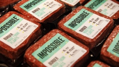 Packages of Impossible Burger plant based meat are displayed for sale during the Impossible Foods Inc. grocery store product launch in Los Angeles, California, U.S., on Friday, Sept. 20, 2019. The Impossible Burger made its retail debut at 27 Gelson's Markets locations in Southern California before expanding its retail presence in the fourth quarter and in early 2020, the company said in a statement. Photographer: Patrick T. Fallon/Bloomberg