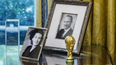 Photographs of U.S. President Donald Trump's parents, Mary Anne MacLeod Trump and Fred Trump, sit on a desk in the Oval Office at the White House in Washington, D.C. Photographer: Zach Gibson/Bloomberg
