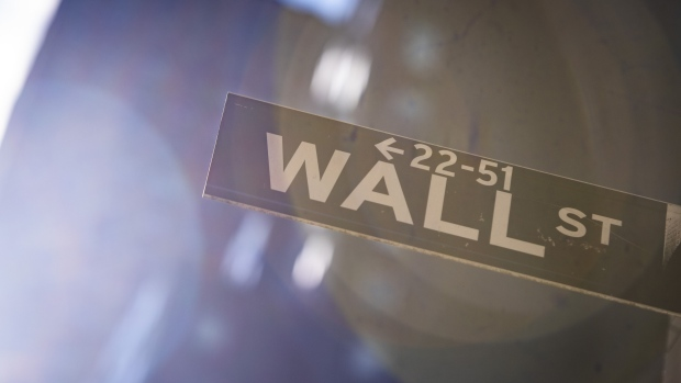 A Wall Street sign is displayed in front of New York Stock Exchange (NYSE) in New York, U.S., on Friday, March 13, 2020. Photographer: Mark Kauzlarich/Bloomberg