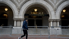 A pedestrian walks past the Trump International Hotel in Washington, D.C, U.S., on Thursday, April 23, 2020. Although the Trump family business was explicitly prohibited from benefiting from federal aid authorized in the last few weeks by Congress, its hotel in Washington is seeking separate relief on $3 million of annual rent that it pays to the U.S. General Services Administration the New York Times reported this week.