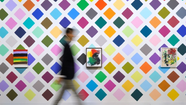 BASEL, SWITZERLAND - JUNE 18: A visitor walks past to the artworks by Martin Creed in the gallery section of Art Basel on June 18, 2014 in Basel, Switzerland. Art Basel one of the most prestigious art fair in the world, which runs until the 22nd of June 2014 will showcase the work of more than 4,000 artists selected by 300 leading galleries. (Photo by Harold Cunningham/Getty Images)