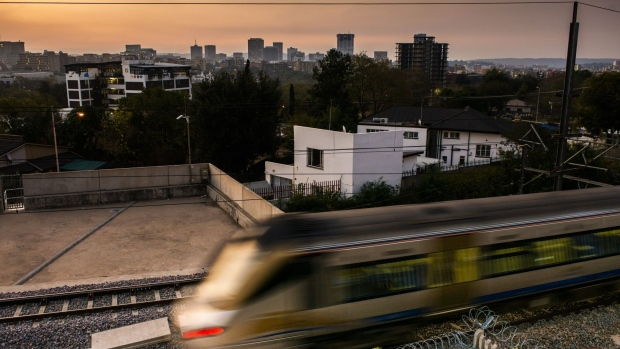 Residential and commercial buildings stand on the skyline as a Gautrain train carriage passes the central business district Pretoria, South Africa, on Saturday, June 1, 2019. While South African President Cyril Ramaphosa says power utility Eskom Holdings SOC Ltd. is considered too big to fail, it could be too big to support because of the costs associated with stabilizing its finances, Engineering News reported, citing S&P Global Ratings Director Ravi Bhatia.
