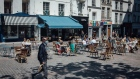 Customers eat and drink on a cafe terrace as France reopens cafes, restaurants and public spaces, in Paris, France, on Tuesday, June 2, 2020. Europe's most virus-stricken countries are preparing to further ease lockdown measures that helped trigger the biggest economic downturn since World War II, even as scientists warned against moving too quickly.