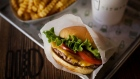 A burger, fries, and beverage are arranged for a photograph at a Shake Shack restaurant in New York, U.S., on Wednesday, Sept. 10, 2014. Shake Shack, the burger chain started by restauranteur Danny Meyer as a kiosk in a New York City park, is preparing for an initial public offering that could value it as high as $1 billion, people familiar with the matter said.
