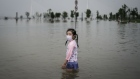 A girl plays in a flooded park in Wuhan on July 10.
