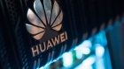 A corporate logo sits on a Huawei Technologies Co. NetEngine 8000 intelligent metro router on display during a 5G event in London.