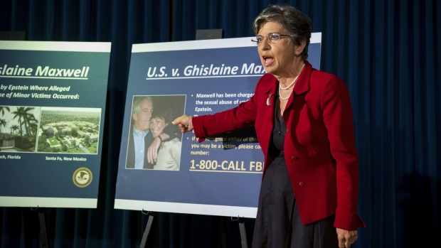 Audrey Strauss, acting U.S. Attorney for the Southern District of New York, points to a photograph of Ghislaine Maxwell and Jeffrey Epstein during a news conference at the U.S. Attorney's Office in New York, U.S., on Thursday, July 2, 2020. Ghislaine Maxwell, a longtime associate of disgraced money manager Jeffrey Epstein, was arrested and charged with conspiracy and enticing minors to engage in sex. Photographer: Michael Nagle/Bloomberg