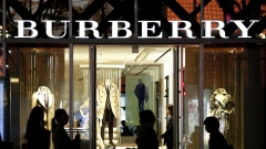 Pedestrians walk past a Burberry Group Plc store in the Omotesando district of Tokyo.