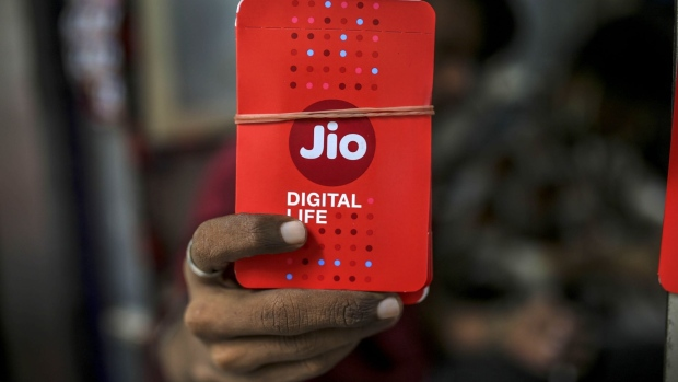 Mobile sim card packets for Jio Platforms Ltd., the mobile network of Reliance Industries Ltd., are displayed for a photograph at a store in Mumbai, India, on Tuesday, July 14, 2020.