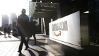 Pedestrians walks past Amazon.com Inc. headquarters in the financial district of Toronto, Ontario, Canada, on Friday, Feb. 21, 2020. Canadian stocks declined with global markets, as authorities struggled to keep the coronavirus from spreading more widely outside China. However, investors flocking to safe havens such as gold offset the sell-off in Canada's stock market. Photographer: Stephanie Foden/Bloomberg