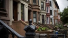 Brownstone buildings line a street of the Bedford-Stuyvesant neighborhood in the Brooklyn borough of New York.
