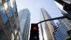 A crosswalk sign flashes red in the financial district of Toronto, Ontario, Canada, on Friday, May 22, 2020. Whether the PATH, a subterranean network that provides connections between major commuter stations, over 80 properties, including the headquarters of Canada's five largest banks, and 1,200 retail spots, can return to its glory days will depend initially on how quickly Bay St. firms return workers to their offices.