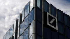 The Deutsche Bank AG logo sits on an office building in Frankfurt, Germany, on Wednesday, April 25, 2018.