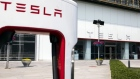 The Tesla Inc. logo is displayed outside one of the company's showrooms in Beijing, China, on Friday, May 10, 2019.