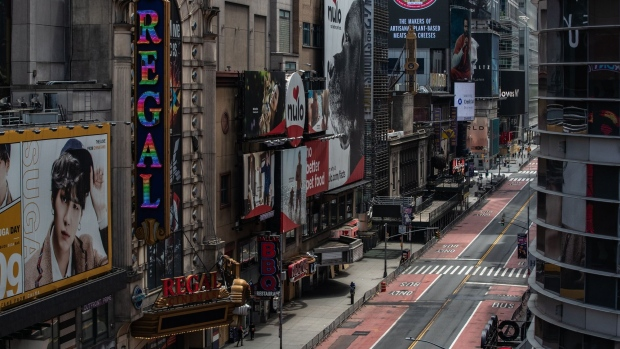 A nearly empty street is seen in Times Square in New York on June 11. Photographer: Jeenah Moon/Bloomberg