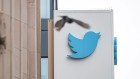 A bird flies near signage displayed outside of Twitter headquarters in San Francisco, California, U.S., on Thursday, July 16, 2020.
