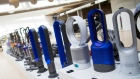 Dyson fans stand on display in a staff area at the Dyson Group campus in Malmesbury, U.K. on Sept. 26.