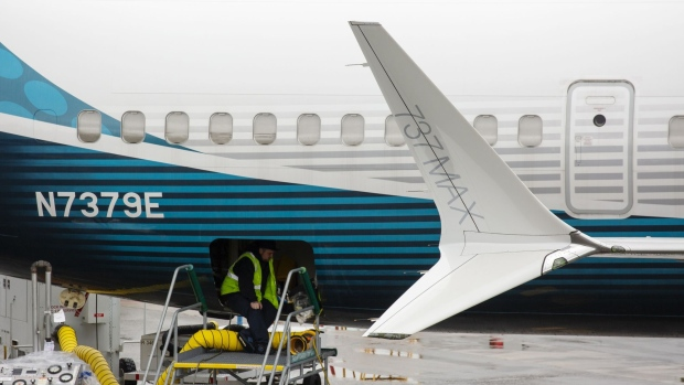 An employee works on a Boeing Co. 737 Max 9 plane at the company's manufacturing facility in Renton.