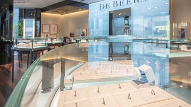 Diamond jewelry is displayed in cabinets inside a De Beers SA store in Hong Kong, China, on Thursday