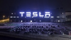 The Tesla Inc. Gigafactory stands illuminated at night in Shanghai.