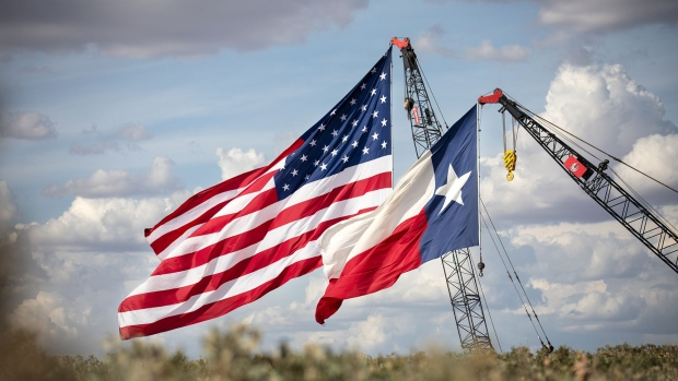 MIDLAND, TX - JULY 28: The American and Texas flags are raised at the site of a Double Eagle Energy rig on July 28, 2020 in Midland, Texas. President Donald Trump is making his 16th visit to the state, where he will tour a rig owned by Double Eagle Energy and deliver remarks. (Photo by Montinique Monroe/Getty Images)