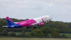 A passenger aircraft, operated by Wizz Air Holdings Plc, takes off as it departs from London Luton Airport in Luton, U.K., on Friday, May 1, 2020.Wizz Air plans to operate 10% of its scheduled flights for passengers with essential journeys from the airport today, the Evening Standard reports, citing the company.