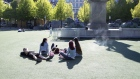 People gather at a park in the afternoon sun at Kungstrdgrden in Stockholm on May 22. Photographer: Loulou D'Aki/Bloomberg