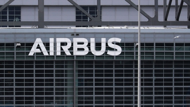 An Airbus SE logo sits on the company's aircraft assebly factory in Hamburg, Germany, on Wednesday, May 13, 2020. Airbus secured just nine net orders in April and delivered 14 jetliners after airlines desperate for cash put off accepting new planes and clamped down on spending to deal with a crisis that could last several years. Photographer: Krisztian Bocsi/Bloomberg