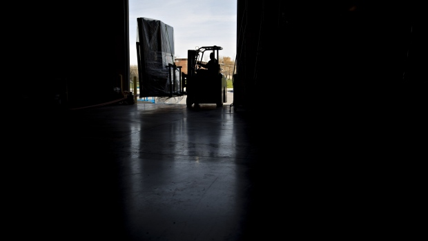 A worker uses a forklift to move packages at a facility in Baltimore. Photographer: Andrew Harrer/Bloomberg
