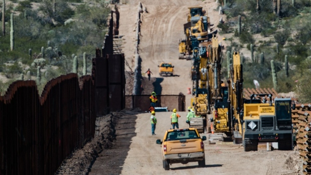 Contractors inspect the work site following detonations on Monument Hill to clear space for a new border wall in Lukeville, Arizona, U.S., on Wednesday, Feb. 26, 2020. Construction crews are bulldozing through Monument Hill to construct a 30-foot steel wall along the U.S.-Mexico border, the Arizona Daily Star reported.