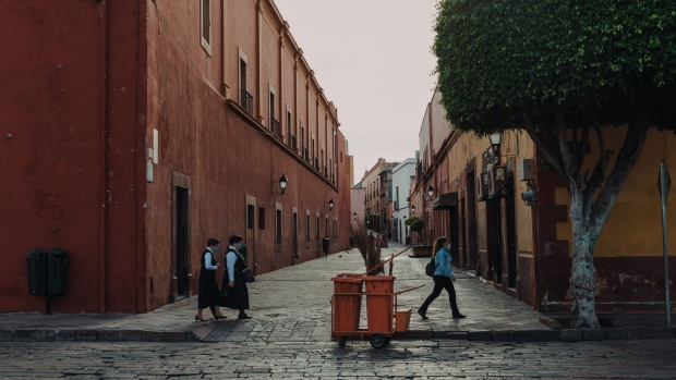 Nuns wearing protective masks walk along a street in Queretaro, Mexico on July 21.