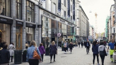 Pedestrians pass retail stores on a shopping street in Oslo, Norway, on Friday, Sept. 22, 2017. Norway's sovereign wealth fund hit $1 trillion for the first time on Tuesday, driven higher by climbing stock markets and a weaker U.S. dollar.