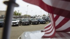 Vehicles are displayed for sale at a General Motors Co. Buick and GMC car dealership. Photographer: Angus Mordant/Bloomberg