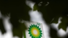 A BP Plc logo sits at the top of a totem sign at a filling station in London, U.K., on Monday, June 8, 2020. BP Plc plans to cut 10,000 jobs as the coronavirus pandemic accelerates the company's move to slim down for the energy transition.