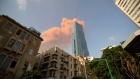 A cloud from a massive explosion is seen in in Beirut, Lebanon, Tuesday, Aug. 4, 2020.