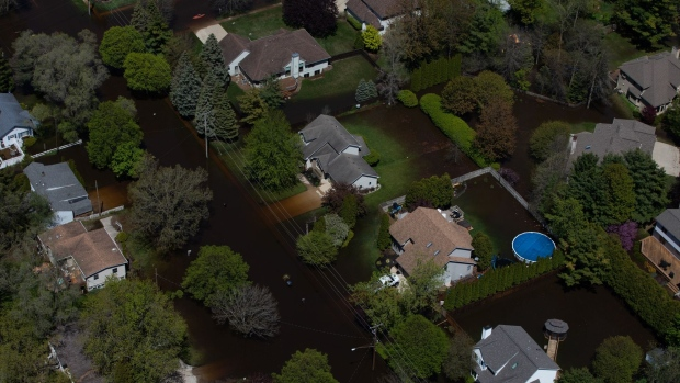 Houses surrounded by flood water are seen in this aerial photorgraph taken after dams failed in Midland, Michigan, U.S., on Wednesday, May 20, 2020. President Donald Trump said he's sending federal emergency workers to Midland, Michigan, where dam failures have flooded a Dow Inc. chemical complex and homes in a disaster that may force the evacuation of more than 10,000 people.